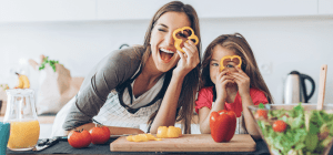 Mother and daughter making food