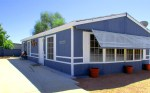Blue double-wide manufactured home with white trim, big windows across the front, and awning - Corner Lot - 161 N 88th Place, Mesa AZ - El Cortez Ranchos - Bill Salvatore, Arizona Elite Properties 602-999-0952 - Arizona Real Estate