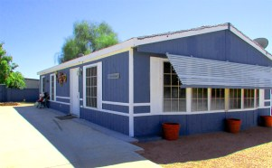 Blue double-wide manufactured home with white trim, big windows across the front, and awning - Corner Lot - 161 N 88th Place, Mesa AZ - El Cortez Ranchos - Bill Salvatore, Arizona Elite Properties 602-999-0952 - Mesa AZ Homes for Sale