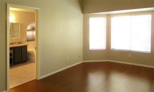 master bedroom with bay window, wood laminate flooring and master bath - 4446 E Desert Wind Dr, Phoenix / Ahwatukee AZ - For Rent - wood laminate flooring in master bedroom - Bill Salvatore, Arizona Elite Properties -602-999-0952 - Elite Property Management
