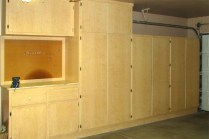 Garage storage cabinets and small workbench - 353 E Jasper Dr, Chandler Arizona - cabinet storage in 2-car garage - Bill Salvatore, Arizona Elite Properties 602-999-0952 - Arizona Real Estate