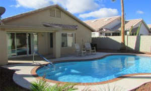 Back of home with sparkling swimming pool - 4446 E Desert Wind Dr, Phoenix / Ahwatukee AZ - Home with pool for rent - Bill Salvatore, Arizona Elite Properties -602-999-0952 - Elite Property Management