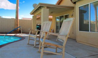 Back patio with rocking chairs next to private pool - 4446 E Desert Wind Dr, Phoenix / Ahwatukee AZ - 3 bedroom home with pool, for rent - Bill Salvatore, Arizona Elite Properties -602-999-0952 - Elite Property Management