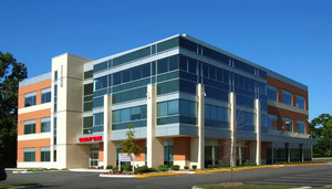 Four story office building in city setting - AZCRE Arizona Commercial Real Estate office building, Commercial Real Estate Listings, Commercial Office, Commercial Land, Retail and Hospitality - Bill Salvatore, Arizona Elite Properties 602-999-0952 - Arizona Real Estate