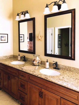 Double sinks in medium dark cabinets and lighter granite countertops, tile flooring - 1151 S Sandstone Street, Gilbert Arizona - Beautifully Updated Master Bath - Bill Salvatore, Arizona Elite Properties 602-999-0952 - Arizona Real Estate