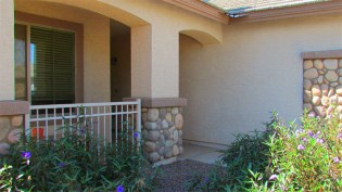Front patio with arched openings and white iron fence - 1795 W Gold Mine Way, Queen Creek, Arizona 85142 - Fenced front patio - Bill Salvatore, Arizona Elite Properties 602-999-0952 - Arizona Real Estate