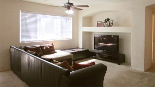 white walls and light, neutral carpeting, entertainment nook with shelf in greatroom - 1795 W Gold Mine Way, Queen Creek, Arizona 85142 - Greatroom with entertainment shelving - Bill Salvatore, Arizona Elite Properties 602-999-0952 - Arizona Real Estate