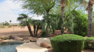 Small shaded patio with two chairs near golf course fence - Pool with Golf Course View - 1205 S Sandstone Street, Gilbert AZ 85396 - Western Skies Golf Community - Bill Salvatore, Arizona Elite Properties 602-999-0952 - Arizona Real Estate
