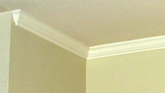 Upper corner of beige wall with white crown molding - Red ROX Condominiums, Unit #3002 Crown Molding, 5401 E Van Buren St, Phoenix AZ - Bill Salvatore, Arizona Elite Properties 602-999-0952 - Arizona Real Estate