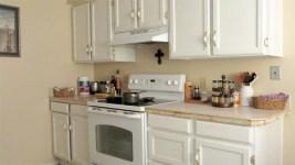 White kitchen cabinets, white countertop with wood trim, white kitchen range - 945 N Pasadena, Mesa AZ - Park Centre Patio Homes - Bill Salvatore, Arizona Elite Properties 602-999-0952 - Arizona Real Estate