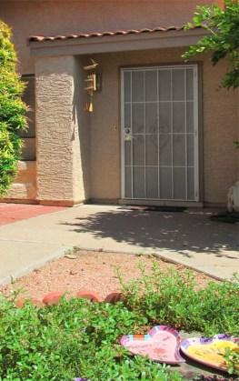 Cement walkway and small garden at front entrance to home - 945 N Pasadena, Mesa AZ - Park Centre Patio Homes - Bill Salvatore, Arizona Elite Properties 602-999-0952 - Arizona Real Estate