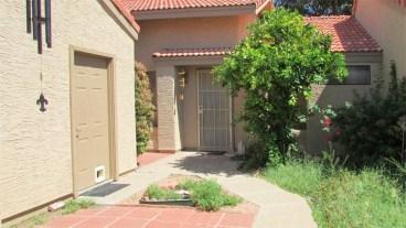 Courtyard with walkway, garage entry, brick patio and gardens - 945 N Pasadena, Mesa AZ - Park Centre Patio Homes - Bill Salvatore, Arizona Elite Properties 602-999-0952 - Arizona Real Estate