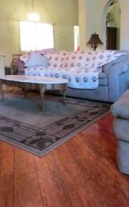 medium dark wood laminate flooring in living room, neutral walls - 945 N Pasadena, Mesa AZ - Park Centre Patio Homes - Bill Salvatore, Arizona Elite Properties 602-999-0952 - Arizona Real Estate