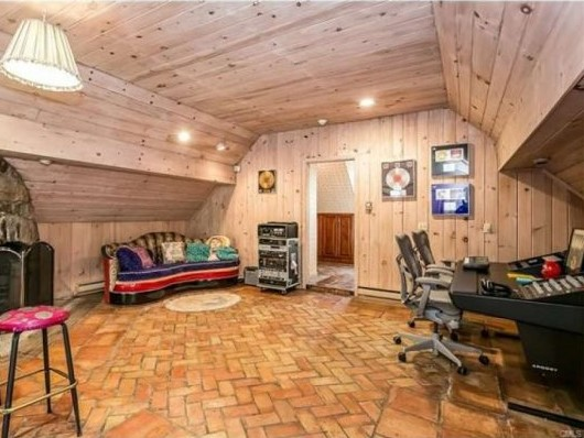 Guest House / Studio with barn-style ceiling, tile floor and whitewashed walls (photo: RIS Media) - Cyndi Lauper's Stamford CT home for sale - Bill Salvatore, Arizona Elite Properties 602-999-0952 - Arizona Real Estate