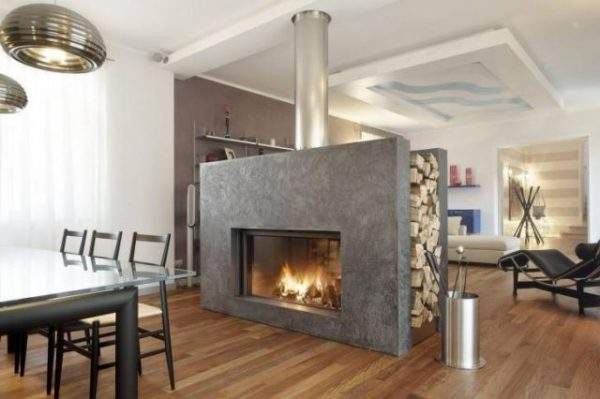 2-sided granite slab fireplace in center of room with metal pipe flu - Contemporary fireplaces, homes for sale with a fireplace - Bill Salvatore, Arizona Elite Properties 602-999-0952 - Arizona Homes for Sale