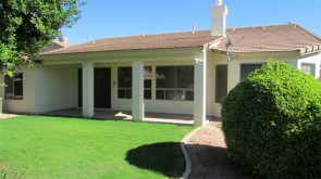 view across grassy back yard to back of house lined with large windows - Lots of natural light - 1162 S Sandstone St, Gilbert AZ - Bill Salvatore, Arizona Elite Properties 602-999-0952 - Arizona Real Estate