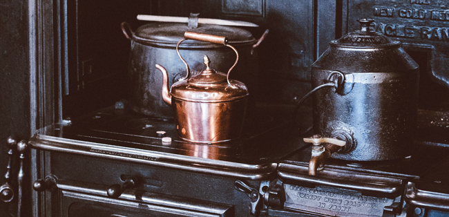 black iron stove with iron pot and copper kettle - retro country kitchen, vintage kitchen, old iron stove, photo-by-annie-spratt-on-Unsplash - Bill Salvatore, Arizona Elite Properties 602-999-0952 - Arizona Real Estate