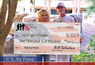 Home buyers holding big check for $1500 cash back - Heroes Home Advantage, Cash Back, Real Estate Discounts, Ed & Lyn Affholder - Bill Salvatore, Arizona Elite Properties 602-999-0952 - Arizona Real Estate