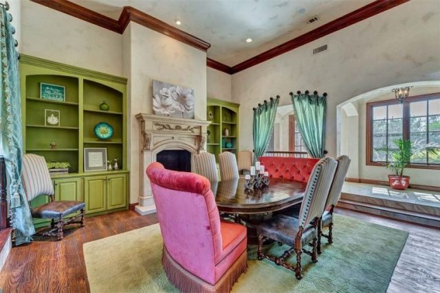 large, dark wood dining table in the center of a colorful room - Dining Room - Selena Gomez's Fort Worth Texas Home for Sale - Bill Salvatore, Arizona Elite Properties 602-999-0952 - Arizona Real Estate