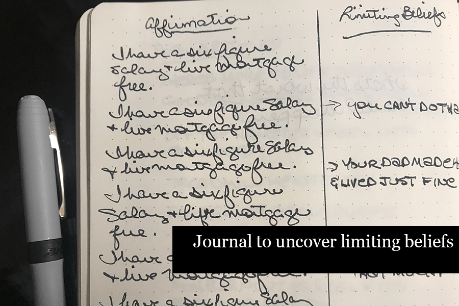 Open journal with handwriting listing affirmations contrasted with limiting beliefs
