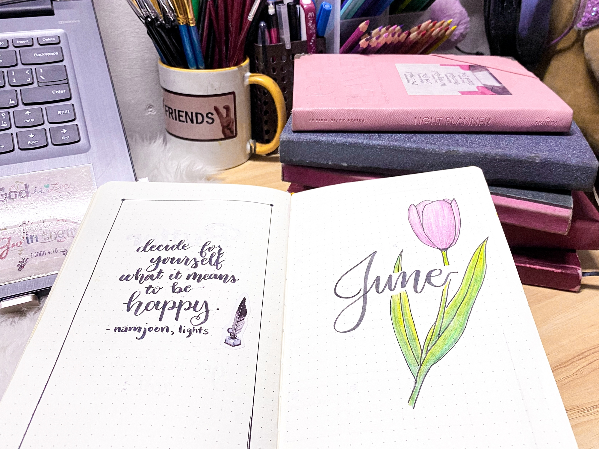 """Open journal on desk that says """"decide for yourself what it means to be happy."""" namjoon, lights"""