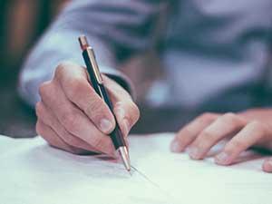 signing pen hands