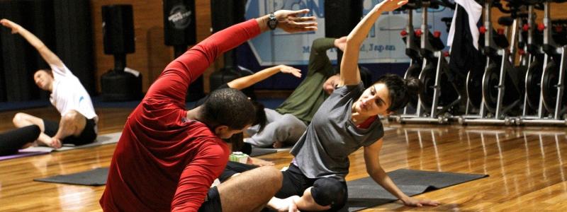 people exercising yoga stretching