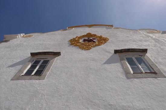 Tavira white building crest