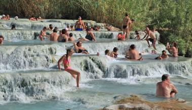 This is Tuscany? I think what really got me heated up over these hot springs -- besides the bumpy calcified natural hot tubs, the crazy looking water and that one girl in the black bikini in that last post -- was that people have been doing this exact same thing, right here, for over three thousand years. Sure, their swimming costumes may have changed, some pagans were probably sacrificed along the way and the fiats are no longer decreed by the Orsinis, but parked along the road, but still... that's a long damn time.