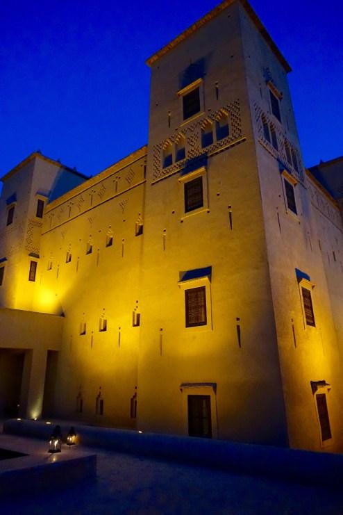 Dar Ahlam towers at night