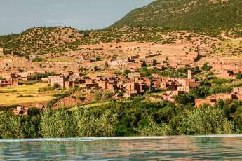 And just for dramatic effect, the infinity pool overlooks across a roaring river valley to a picture perfect Moroccan village clinging to a hillside...