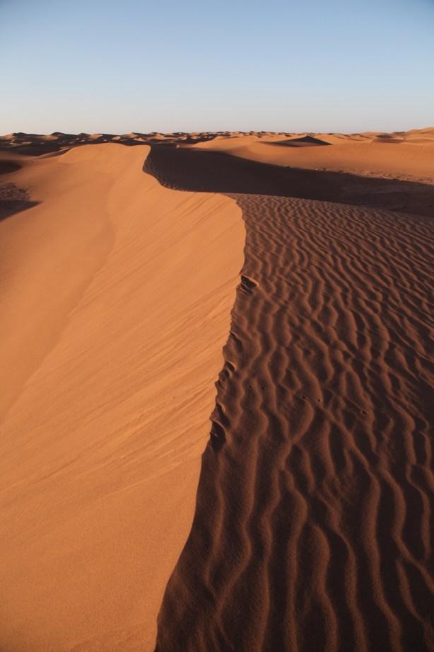 Dar Ahlam Tent Camp sunrise dune ridge