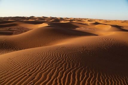Dar Ahlam Tent Camp sunrise dune shadows