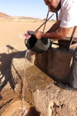 Dar Ahlam Tent Camp desert well bucket