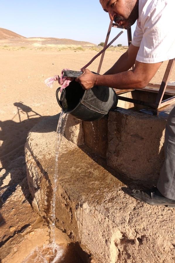 Dar Ahlam Tent Camp desert well bucket