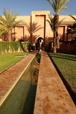 Amanjena reflecting pool sunset