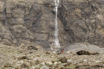 Cirque de Gavarnie waterfall and hiker