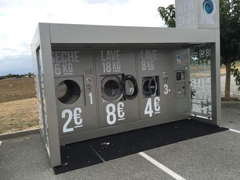 I just loved stumbling on this. A cool little washing machine sled they just drop in the parking lot of the local supermarche and hook up. People just come and do bulk loads of laundry. Brilliant idea.