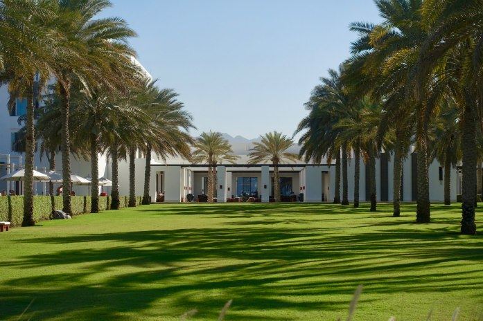 Chedi Muscat grassy grounds