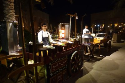 They have special theme nights to switch things up, like this special Arabic feast down by the beach, with different stations serving up amazing side dishes.