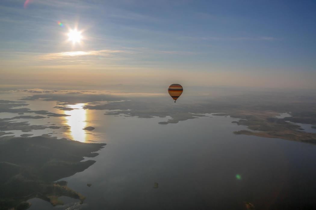 Balloon over Alqueva Reservoir at sunrise