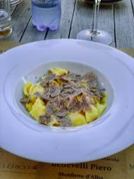 "Come get the most perfect specimen of ""plin"" a regional pinch of pasta, topped with the treasured shaved white truffles."