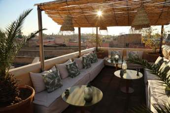 Riad 72 rooftop lounge at sunset