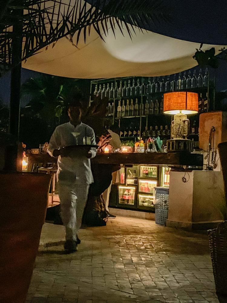 El Fenn waiter carrying drinks