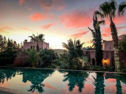 Le Jardin des Douars pool at sunset