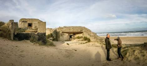 As Mathias pointed out, these big gun batteries weren't pointed out to sea, with a narrow firing range at single ships. They were points DOWN the beach, where they can constantly pummel the landing troops for miles, their muzzle flashes invisible from battleships from the sea. (Awesome photo courtesy of my cousin Joe @foginchicago)