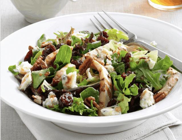 Crunchy pecan salad in white bowl