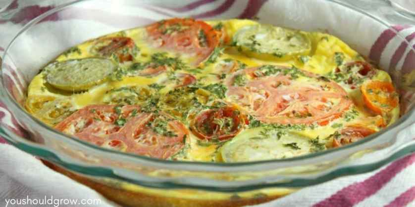 Heirloom tomato and basil frittata in glass pie dish
