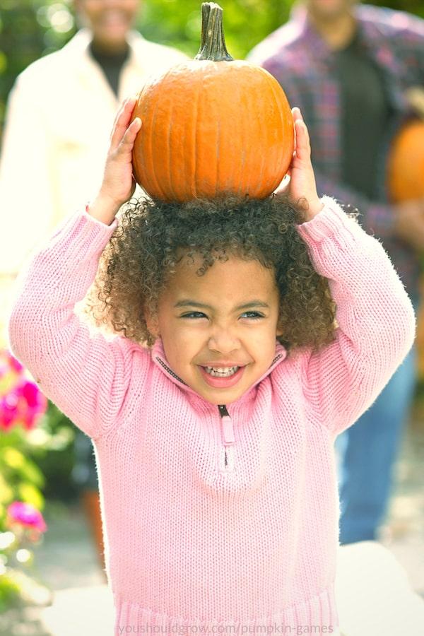 girl playing pumpkin games