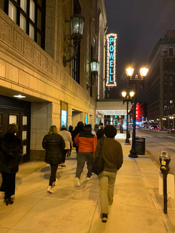 Large group of Youth Art Team artists walking into Powell Symphony Hall, home to the Saint Louis Symphony.